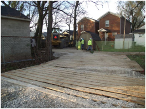 Due to recent rainfall, swamp mats must be used by crews to access wet yards with heavy equipment and continue cleanup work. Photo: Virginia Lewis.