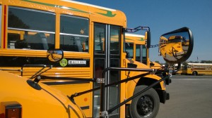 Crittenden County's new propane school buses (foreground) replaced several older diesel models, seen in the background.